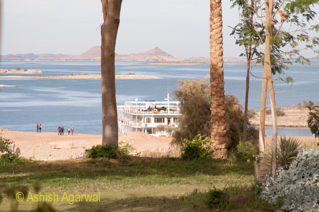 View of cruise ship through trees at the temple of Abu Simbel in Egypt