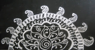 mehandi designs are drawn with mehandi cone that is available in the
