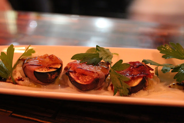 Prosciutto-wrapped figs at Aragosta Bar + Bistro, Boston, Mass.