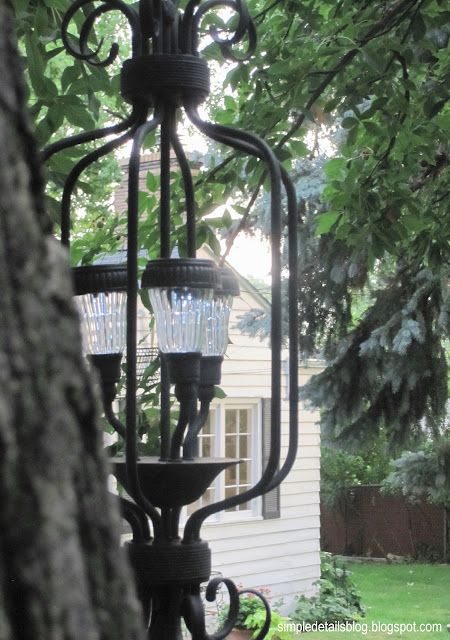 Simple details diy outdoor solar chandelier for Solar light chandelier diy