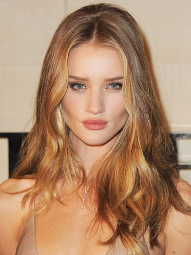 Light sandy brown base with strawberry blonde balayage around the ...