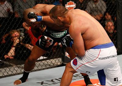 Dan Henderson punching Rashad Evans at UFC 161