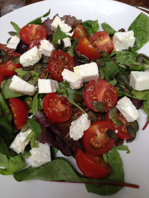spinach and mixed leaf salad with a selection of seeds, tomato and feta