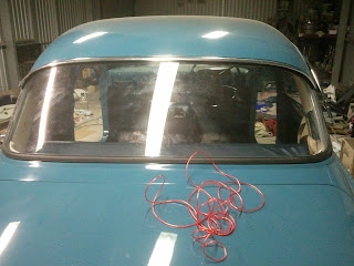 Rear window Volvo Amazon fitted with a the help of a washing line