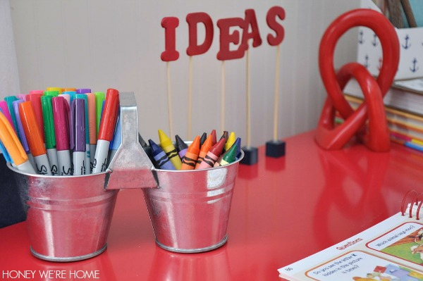 Corral markers and crayons in galvanized tins