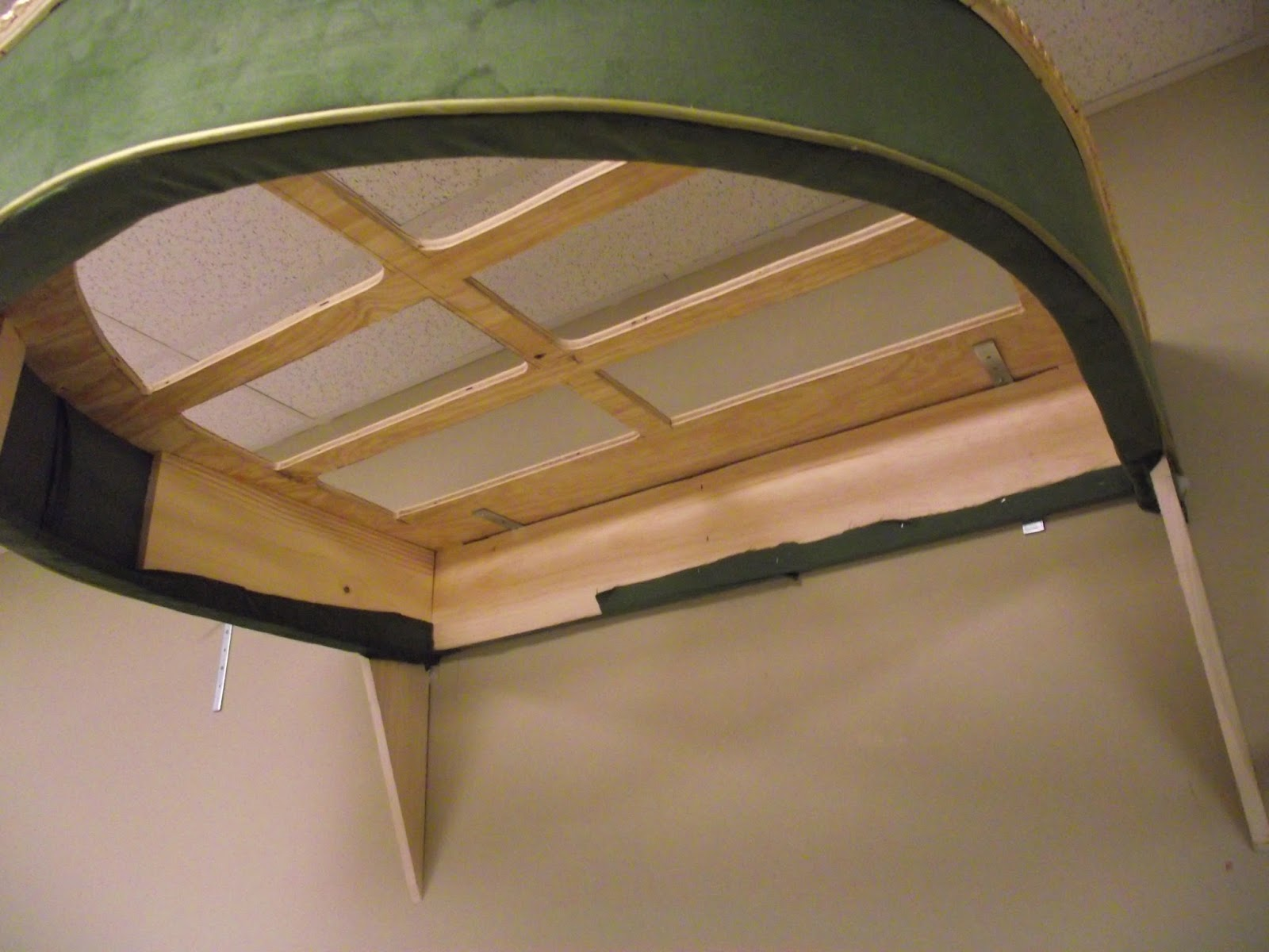 the canopy had to be mounted 11 feet high to give the room much needed drama and a focal point