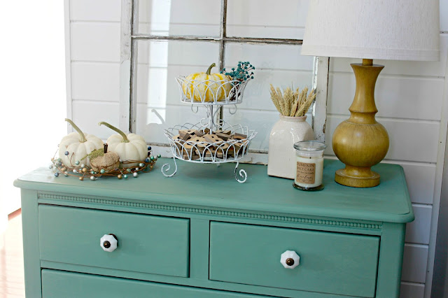 Pumpkins and a neutral Fall vignette with a pop of blue