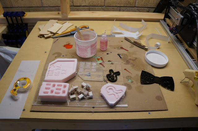 finished molds on desk with original pieces nearby