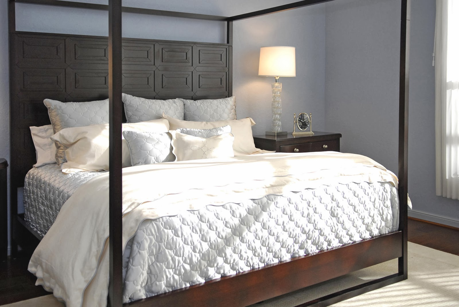 Modern White Pillar Bed Is Elegant In All White Upholstery And Dark