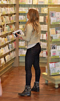 Hilary Duff lookink at thank you cards in a store