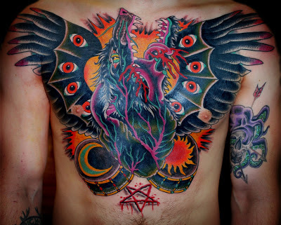 Tattoo of a satanic dragon with pentagram, wings, and moon by tattoo artist Jason Kunz for Triumph Tattoo