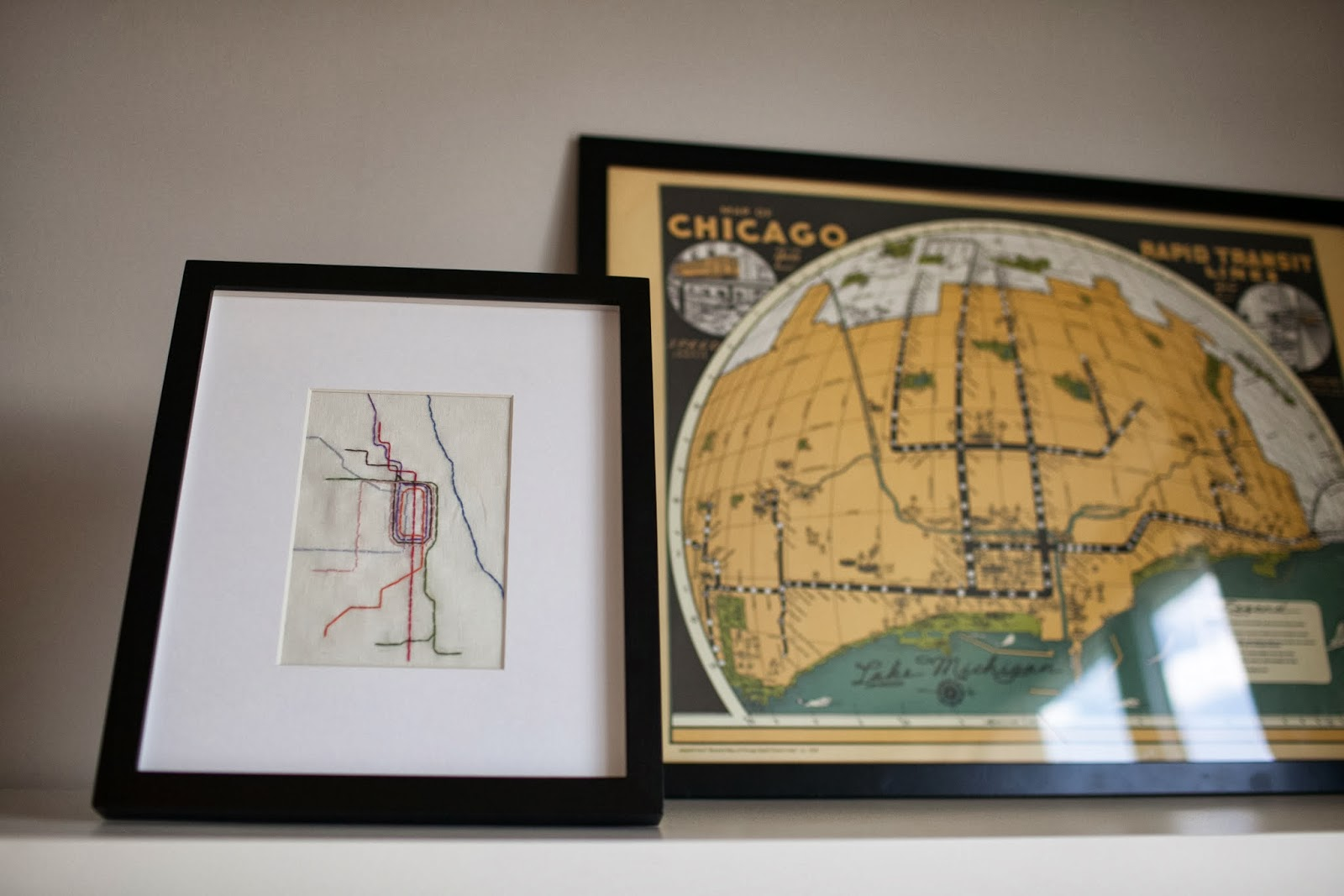City lights nursery tour maps above the bookshelf the large yellow map is a vintage map of the chicago transit system also purchased at posh the small embroidered one is a map gumiabroncs Choice Image