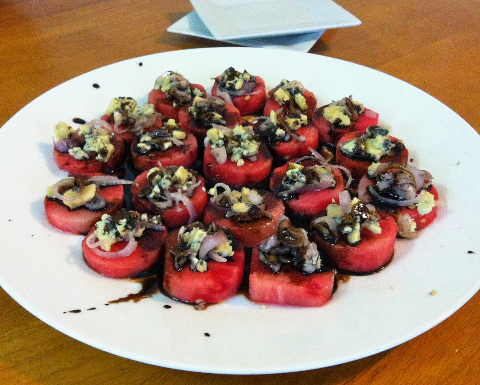 watermelon rounds topped with shallots, blue cheese, balsamic reduction @ Southern Spoon Blog