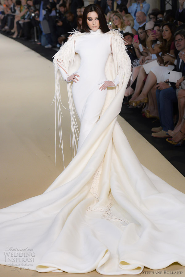 Long capes from stephane rolland fall 2012 for wedding for Wedding dress with cape train