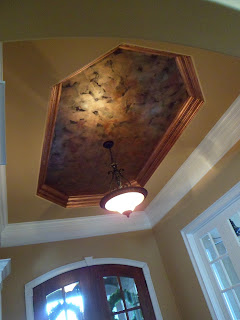 copper leafed trim, metallic foyer ceiling,