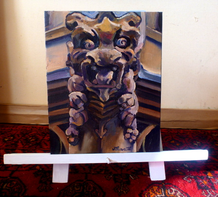 "oil painting of ""Gargoyle on spire of Maclaurin Hall, University of Sydney""  displayed on a Table easel made of recycled timber by artist Jane Bennett"