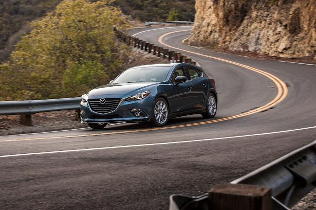 Front 3/4 view of 2016 Mazda 3 S Five-Door Grand Touring