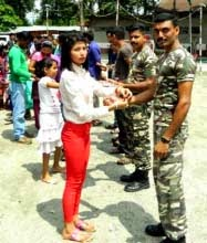 Girls tie rakhi to SSB personnel at Kalpokhari village near Mirik