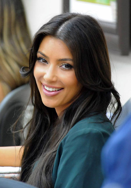 kim kardashian back to dark hair getting manicure and pedicure