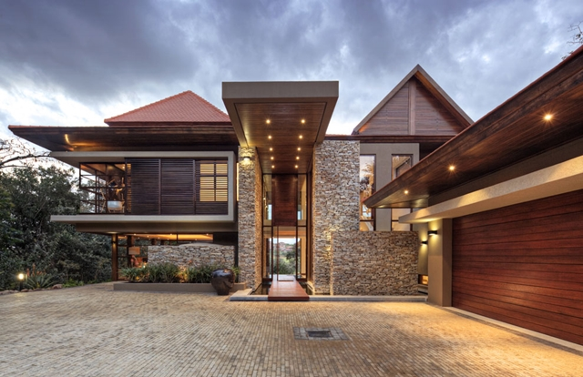 Front side and entrance into Contemporary South African SGNW House by Metropole Architects with garage on the right side