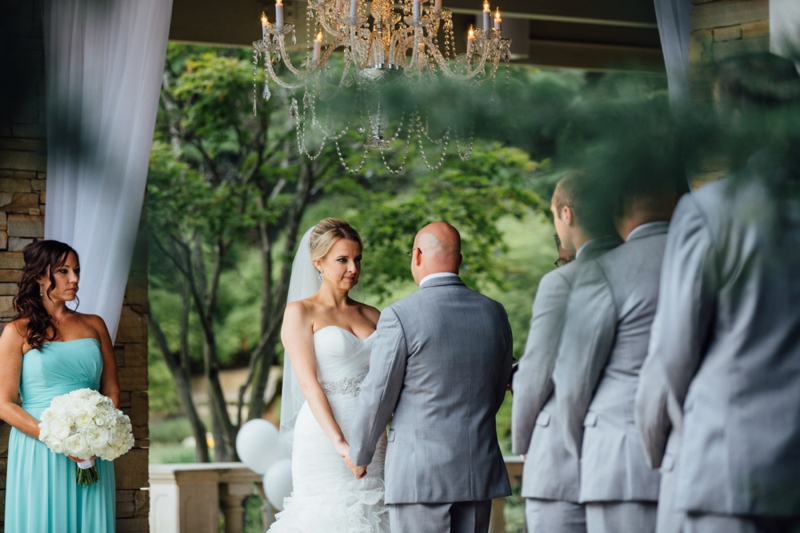 saying their vows at Villa Christina