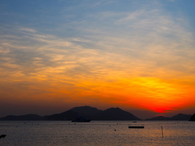 Pink, blue, orange and red skies of the sunset on Repulse Bay Beach, Hong Kong