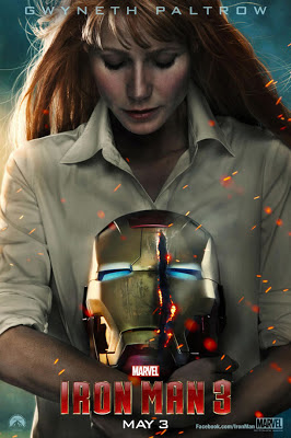 Pepper Potts holding a shattered Iron Man helmet poster