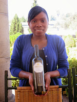 Brigitte Fredericks offering up the fermented grape at Morgenhof Wine Farm, Stellenbosch, South Afr