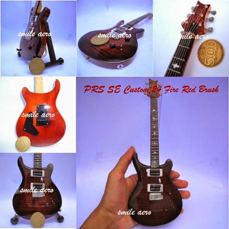 Kado ulang tahun unik berupa miniatur gitar yang juga cocok dijadikan kado pernikahan.