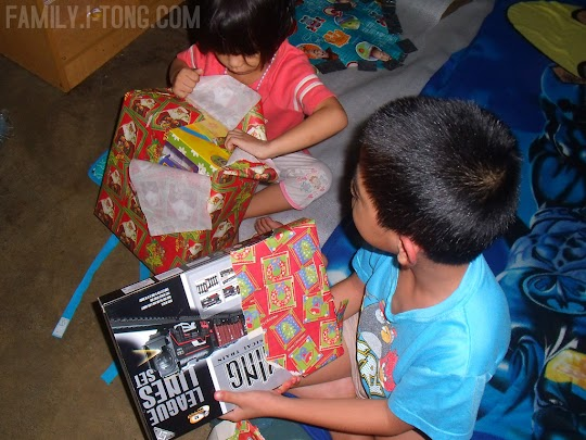 Rain and Rhomiel Opening Their Gifts From Santa Claus