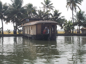 Kettuvallam(Boathouse) anchored at the countryside.