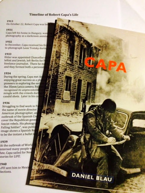 Robert Capa exhibition Flyer - Soldier is sitting on a car