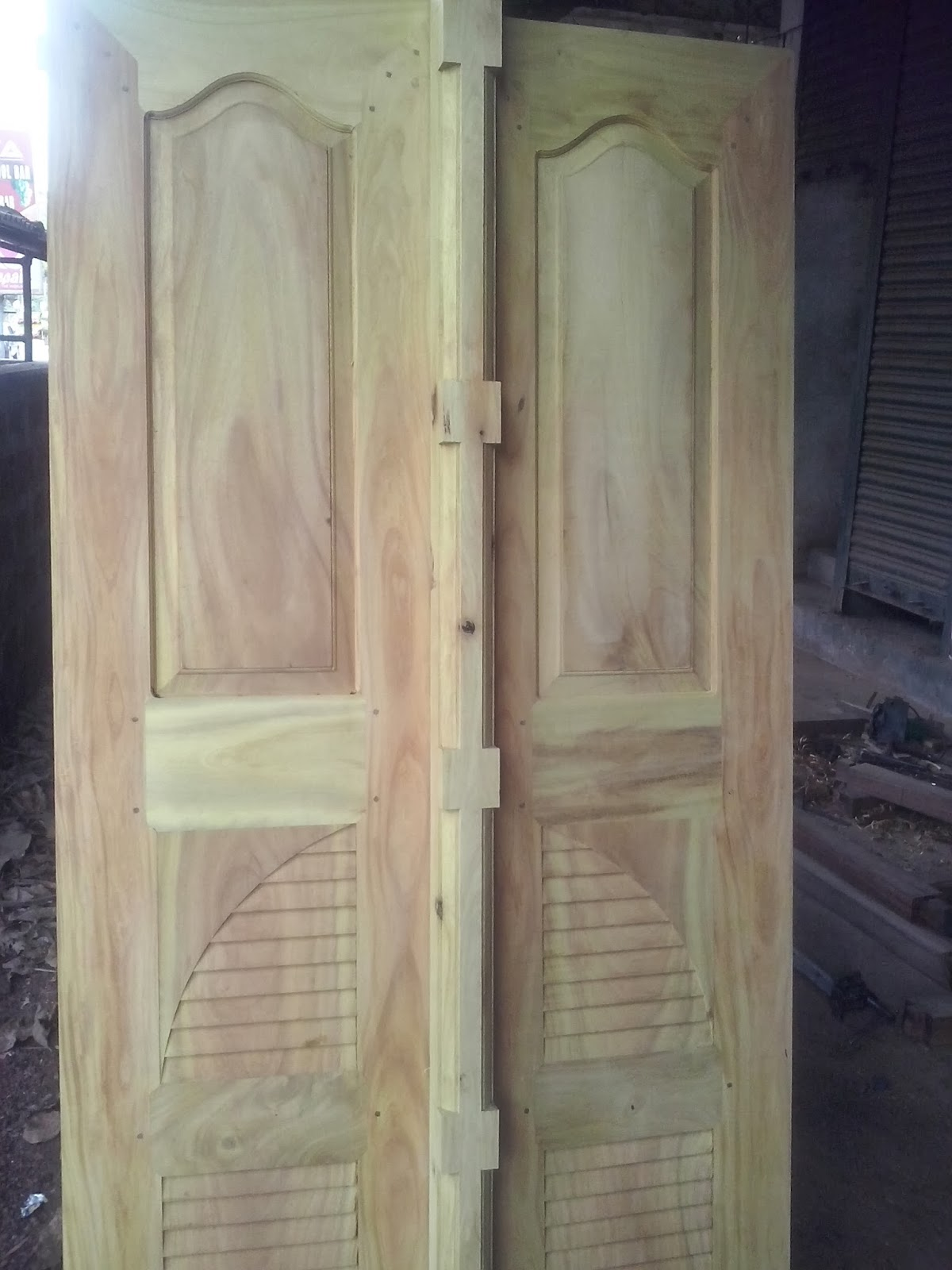 Kerala style carpenter works and designs kerala style for Door design video