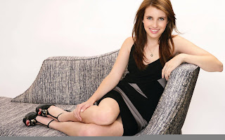 Emma Roberts Showing her legs on Sofa