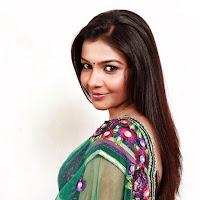 winnning and elegant Kadhal saranya new pics in green saree