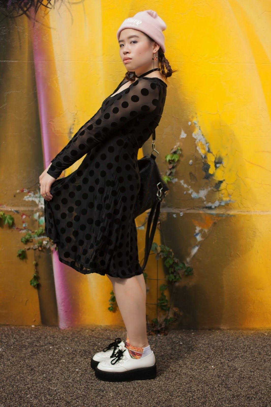 Rainie modelling polka dotted dress and creepers