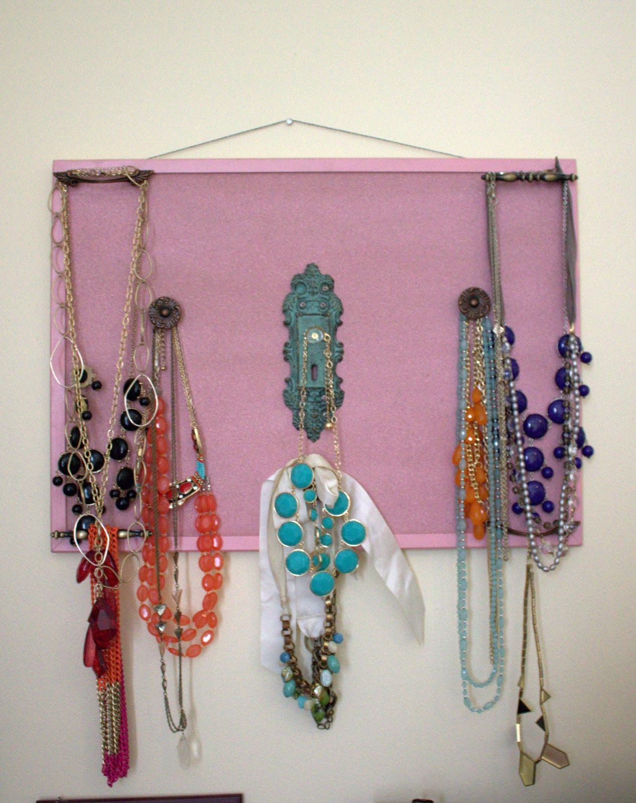 Statement necklace board. I used door knobs and drawer pulls and spray  title=