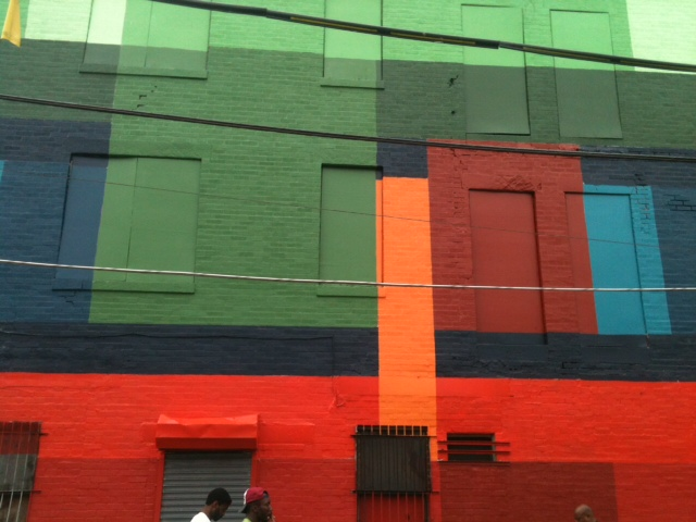 Designer in exile painted city for City mural projects