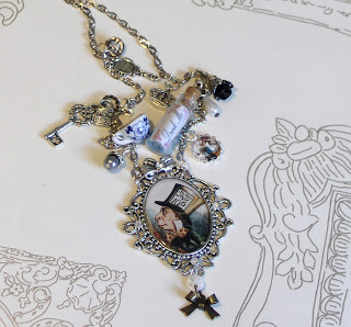 http://folksy.com/items/4947002-Alice-in-Wonderland-charm-necklace-