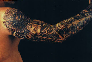 cyborg style tattoo on the arm