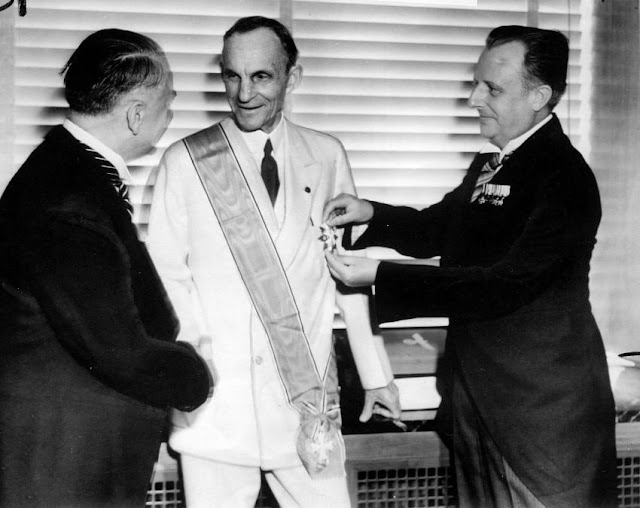 Henry Ford is presented with the Grand Cross of the Supreme Order of the German Eagle.
