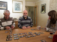 Some of the players, midway through a game of Dominion