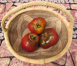 Basket of Three Red and Green Tomatoes