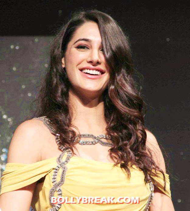 Nargis Fakhri smiling with her hair open - Nargis Fakhri Cute Smiling Photo with Open Hair