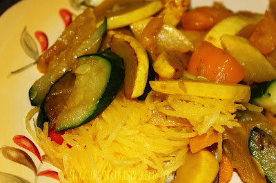 sauteed zucchini, yellow squash and baby sweet peppers on a bed of spaghetti squash