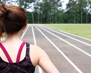 title: cute young girl on track field; taken by: Benjamin Miller; source:freestockphotos.biz