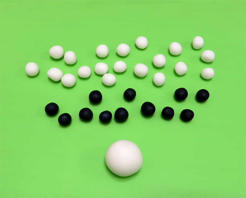 Fondant soccer ball white and black balls close