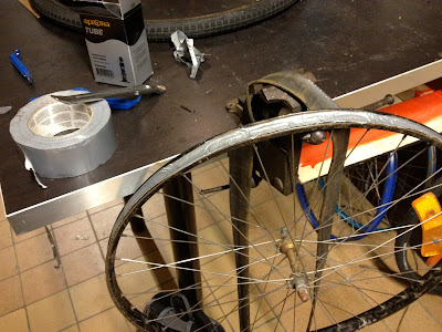 trying to retrofit the old wheel to change the flat, unsuccessfully