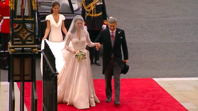 Catherine walking from the car by the side of her father, followed by her sister and Maid of honour. YouTube 2011.