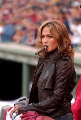 Jennifer Lopez smoking a cigar.